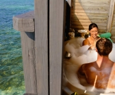 675x900-kuredu-couple-in-jacuzzi-water-villa